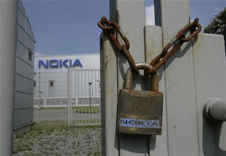 A rusted chain and a lock are seen at a closed gate of the Nokia mobile phone plant in Bochum